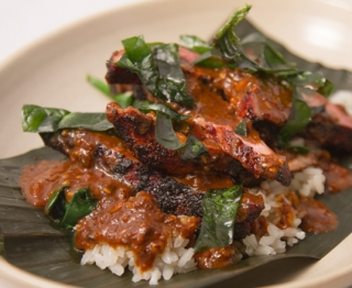 DUCK in SALSA MACHA:  Grilled, red chile-rubbed Gunthorp duck breast, dried fruit salsa macha (mulato, ancho, pasilla, nuts, seeds, raisins, cherries), Gulf-style white rice, Snug Haven spinach two ways
