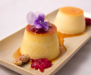 "Duo de Flanes: Traditional Mexican vanilla flan and orange ""creamsicle""  flan.  Nichol's Farm cranberry salsa, frosted walnuts."