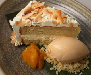 Moist coconut cream cake, Mexican vanilla buttercream, toasted coconut, boozy agave tangerines, guava frozen yogurt, coconut crumble