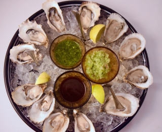 Shucked to order, served with cucumber-arbol shaved ice, smoky-spicy salsa negra, herby green-chile adobo