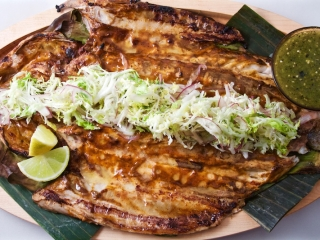 Butterflied Anguilla Farm striped bass, grilled with red chile adobo glaze