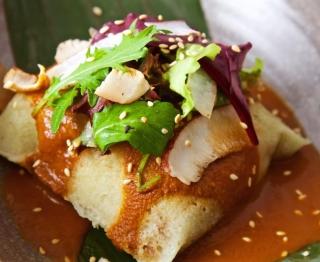Fresh corn masa tamal (Mazatlan blue shrimp & young coconut filling, banana leaf wrapper), coconut pipián (ancho, toasted coconut, sesame), Bayless garden greens