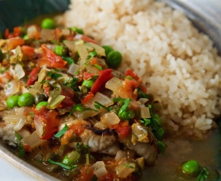 Garlicky fish cooked over the coals,  Tampico-style pan sauce (local fresh tomato, olives, capers, peas, serrano, white wine, fish broth), Gulf-style white rice.