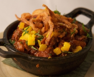 "Grill-roasted Gunthorp pork, tangy guajillo ""bbq"" sauce, fresh honey Manila mango, potatoes, crispy onions"