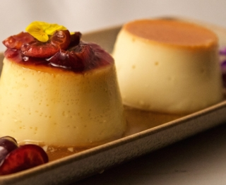 Almond-cream cheese flan with chipotle cherry compote, and classic Mexican vanilla flan