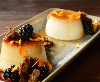 Duo of Mexican caramel custards: classic Mexican vanilla and orange-lemon thyme flan. Local blackberries, oat-walnut clusters.