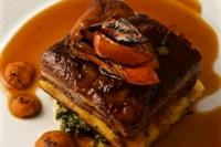 Braised Creekstone short rib, woodland mushroom bread pudding, creamy wild greens, white sweet potato, mole de olla (Rich beef broth infused with guajillo chile & aromatics)
