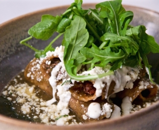 Crispy smoked chicken taquitos, roasted tomatillo sauce, homemade crema, añejo cheese, fresh herbs