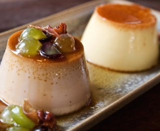 Duo of Mexican caramel custards: Classic Mexican vanilla flan, and goat's milk-walnut flan with black pepper, honey candied walnuts, crispy prosciutto