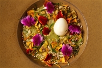 "Chileatole | Fresh-ground corn masa ""porridge,"" charred fresh corn, serrano chile, wild greens, bitter herbs, quail egg, flowers"