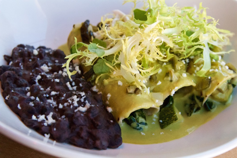 Creamy roasted poblano sauce with smoked chicken or grilled vegetables, Oaxacan black beans with avocado leaf