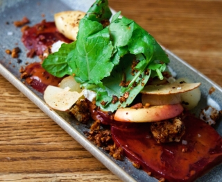 "Roasted beet and grilled apple salad, local goat cheese, ancho chile dressing, ancho-pecan crunch, limey ""compressed"" apples, apple chips, Bayless garden greens"