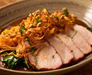 """Grill-roasted pork loin, almond-thickened manchamenteles (ancho, almonds, peanuts, pineapple, spices), rustic mashed butternut (bacon, rompope), local """"winter"""" spinach."""