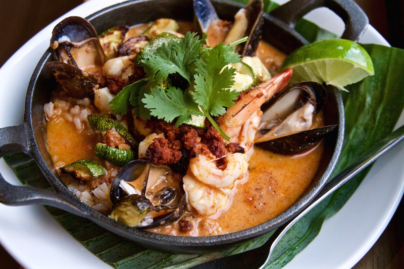 Brothy paella of garlicky shrimp, mussels, bay scallops, roasted vegetables, plantain, rice, homemade chorizo