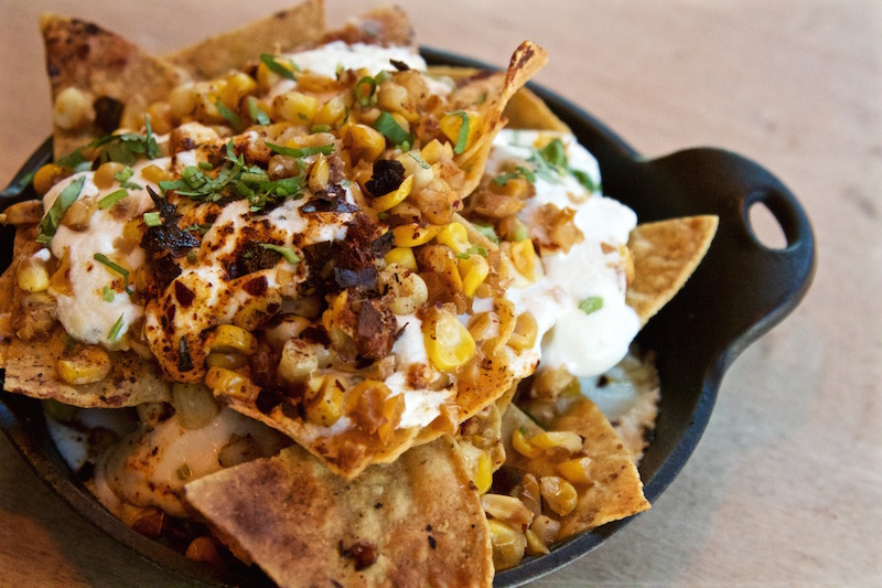 Crispy tortilla chips, grilled sweet corn with mayo and crema, knob onions, añejo cheese, crushed chile, lime