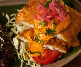 Crunchy-coated New England skate wing, red chile mayo, pickled onions, ensaladita (Savoy cabbage, tomato, cilantro). Garlicky black beans