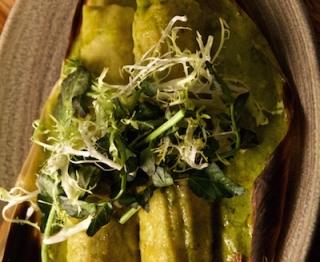 Sweet corn tamales, roasted poblano-mushroom filling, poblano crema, melted artisan Jack, frisée-watercress salad.