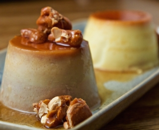 Duo of Mexican caramel custards: Tropical guava-cream cheese flan and classic Mexican vanilla flan. Caramelized cashews.