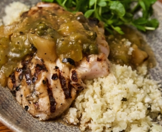 """Wood-grilled Feature Fish, chunky roasted tomatillo-güero sauce (mezcal-infused dried apples, capers, olives), cauliflower """"rice"""""""