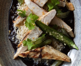 Grilled chicken breast, black bean-jalapeño sauce, crispy chicken chicharrón, charred jalapeño, gulf-style white rice, snap peas.