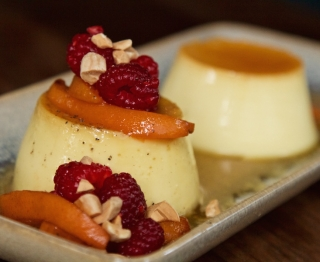 A duo of caramel custards: one Mexican vanilla flan, the other toasted almond flan with honey & black pepper. Honeyed local apricots and raspberries