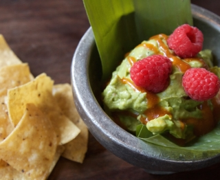 Mashed Michoacan avocadoes, Honey Manila mango, pickled morita chile, knob onions. Chamoy drizzle, local raspberries.