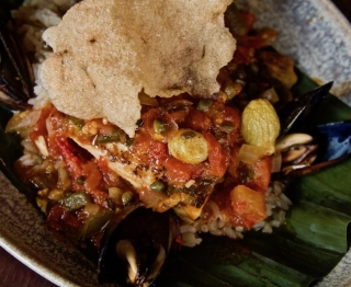 Gulf red snapper, Hudson Bay mussels, classic sauce (tomatoes, jalapeños, capers, olives, sweet spices, almonds, raisins, herbs), classic white rice